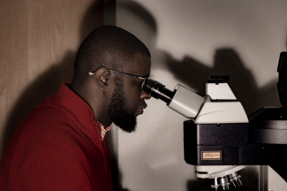 Abdus-Saboor at Microscope
